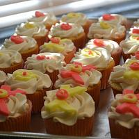 Pink and yellow bow cupcakes