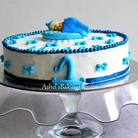 Blue and white theme cake for a boy baby