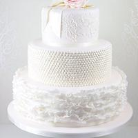 Blush pink ruffles, lace and rose wedding cake