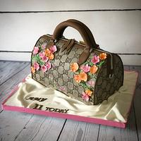 Handbag cake with 3D and painted flowers