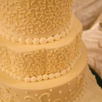 Multi-shape, multi-swirl wedding cake