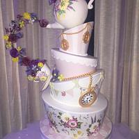 Topsy turvy mad hatter wedding cake