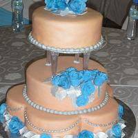 Peach and turquoise wedding cake