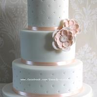 White and peach wedding cake