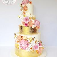 Gold leaf and peachy/pink wedding cake