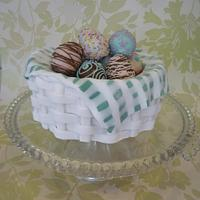 Traditional simnel cake basket with decorated cake pop eggs. by The Faith, Hope and Charity Bakery