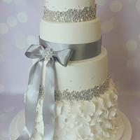 Four tier white and silver wedding cake