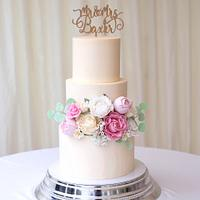 Tiered buttercream cake with handmade sugarpaste flowers