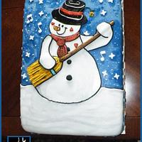 THE SNOWMAN PLAYING A BROOM STICK GUITAR CAKE