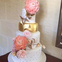 Gold leaf and peonies wedding cake