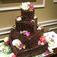 Chocolate cake with chocolate lattice on the sides