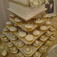 White  & gold wedding cake and cupcakes