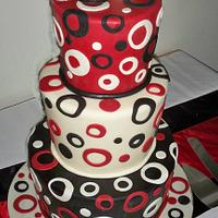 red and black topsy turvey wedding cake