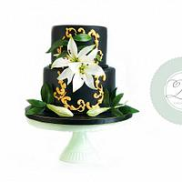 Black wedding cake with white lily