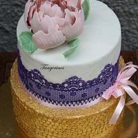 Gold purple and pink themed wedding cake