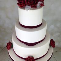 Red velvet Roses and White feathers