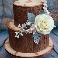 @ Tiered Wood Effect cake with Edible flowers & Leaves for Cuban