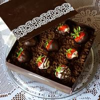 Chocolate cake box with strawberries
