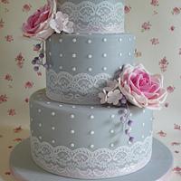 Grey wedding cake with pink roses