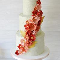 Pale Mint rustic buttercream with coral tone ruffle flowers