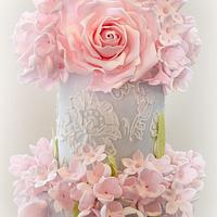 Duck egg blue lace wedding cake with pink sugar flowers