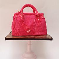 Pink alligator skin handbag