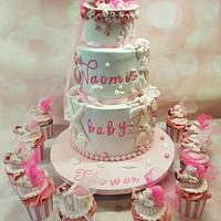 Baby shower shell cake and cupcakes