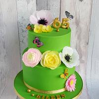 Green cake with wafer paper flowers