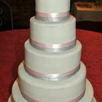 white, silver and dust pink weddin cake