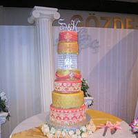 Salmon and gold indianstyle wedding cake
