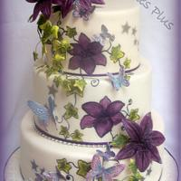 Lily and butterfly wedding cake
