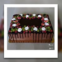 Chocolate birthday cake with fruits