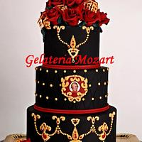 Black wedding cake with red roses, in baroque style