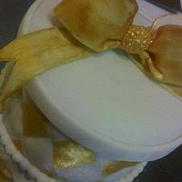 Gold trimmed gift box cake