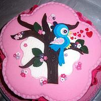 Pink cake with tree and bird by Take a Bite
