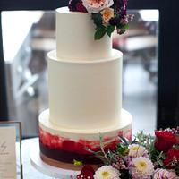 Buttercream cake with deep red watercolour
