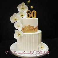 Cascading wafer paper Moth Orchid on white and gold themed cake