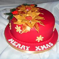 Gold Ponsettia, Holly & Gold Lustred Snowflakes on Burgundy