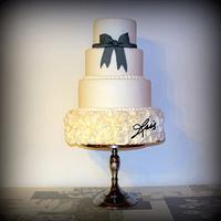 Grey bow white wedding cake