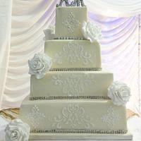 Four tier white on ivory wedding cake
