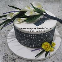 In memory, white calla lillies, baby yellow roses, black lace cake