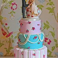 vintage wedding cake with an Alice in wonderland theme :)