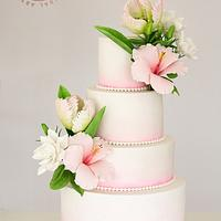Wedding cake with tulips, hibiscus and anemones