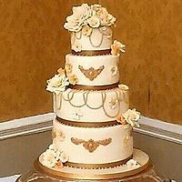 Gold and Cream wedding cake with a hint of peach