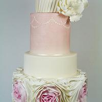 Pretty in pink- omber ruffle wedding cake by Little Miss Fairy Cake