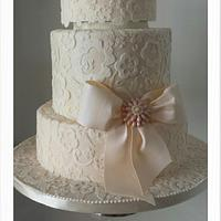 Simple lacy wedding cake