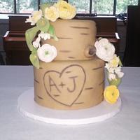 Light tree trunk wedding cake and cupcakes