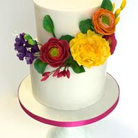Colorful flowers for a christening cake