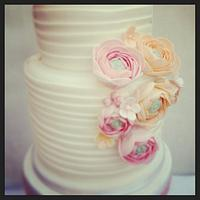 White wedding cake with Ranunculus flowers