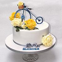 With paper roses and bicycle